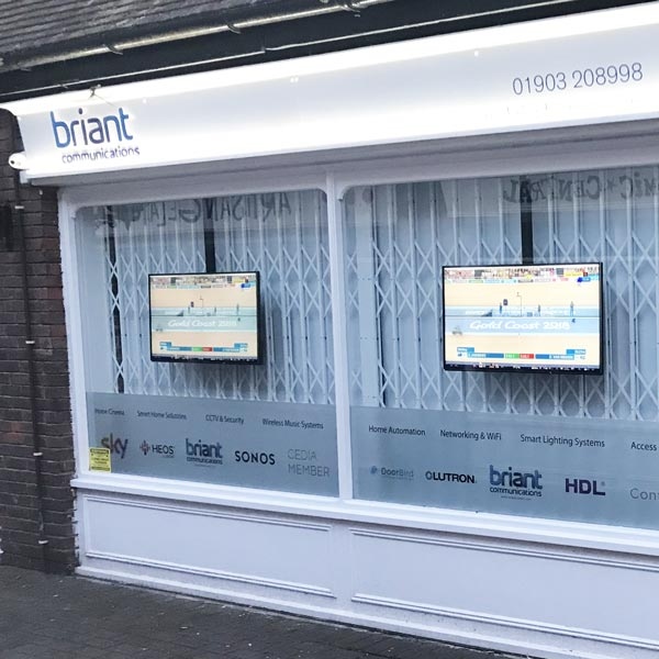 White shopfront with window security bars. Briant Communications
