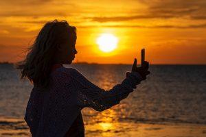 girl phone beach internet access